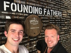 Andy Steves with Stephen McPhilemy, checking out Milltown House's name on the 'Founding Fathers' Wall at the Dingle Distillery